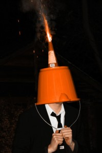 Stupid: Firing fireworks from a bucket on someone's head