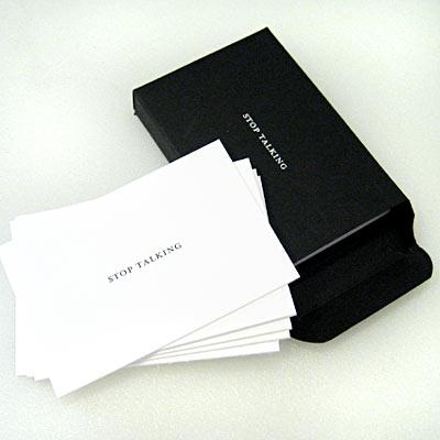 "Raredevices' ""Stop Talking"" cards in matte black letterpressed box"